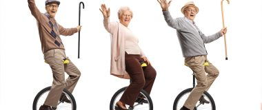 Keeping Your Balance. Photo of seniors on unicycles.