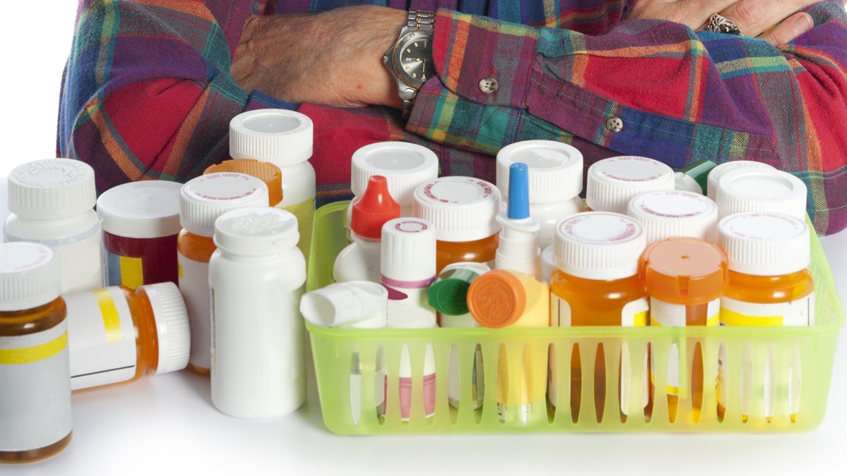 A senior man with his medications