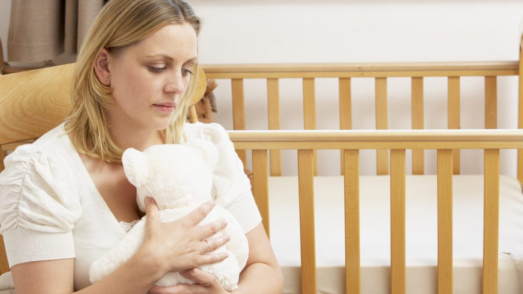 A grieving woman after miscarriage