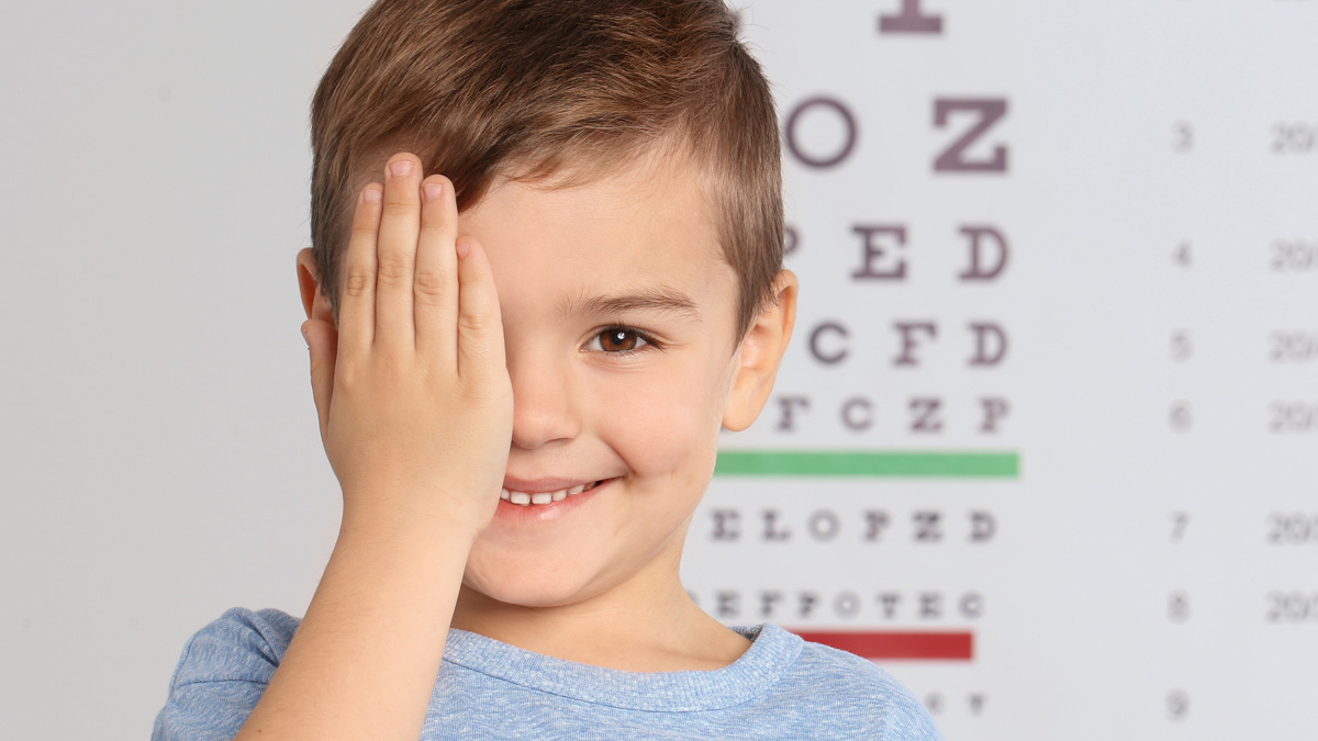 Young boy getting eye exam