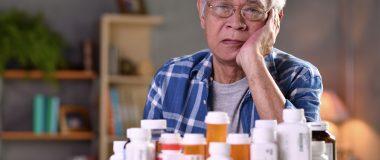 Senior dealing with too many medicine bottles