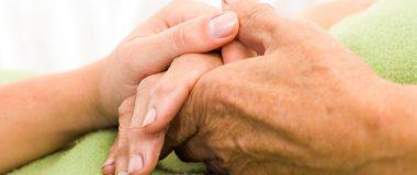 Seniors holding hands
