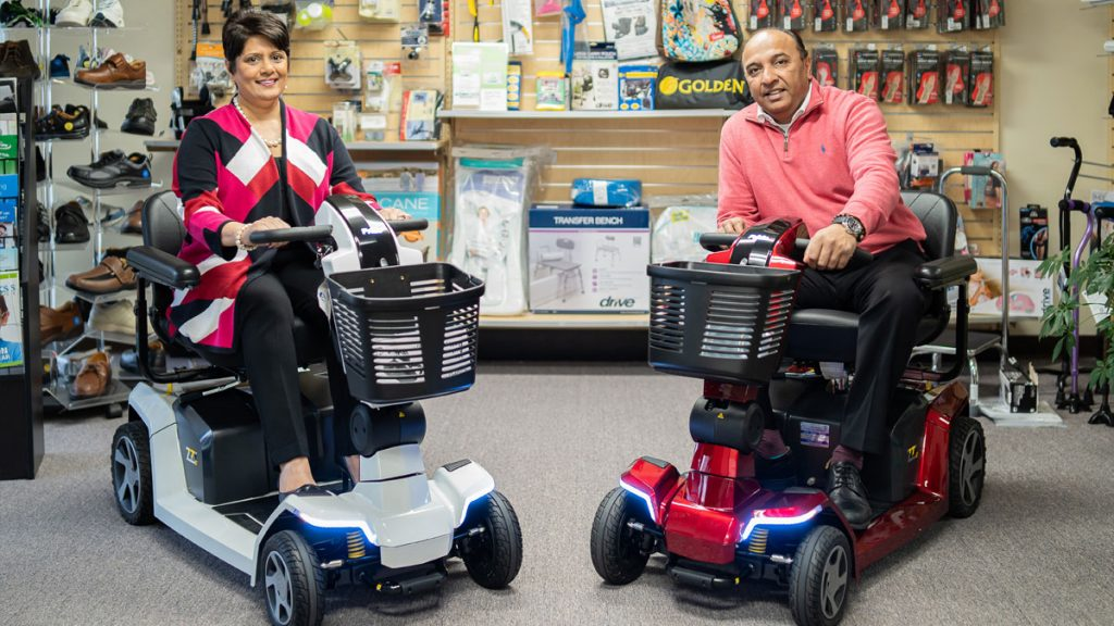 Anita and Roy Patel sitting in electric wheels chairs (Tri-State Medical Supplies)