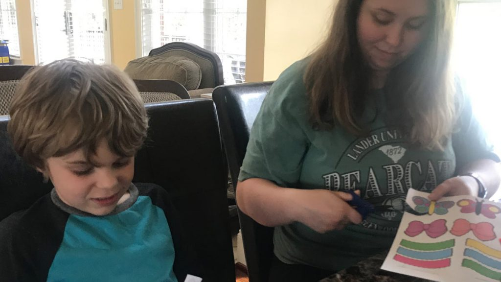 Amber Kneece with her 7-year-old son, Coby