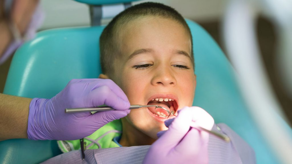 Boy at Dentist Getting Cavity Checkup