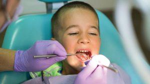 Boy at Dentist Getting Cavity Checkup