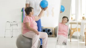 CORA Physical Therapist assisting woman with therapy treatment