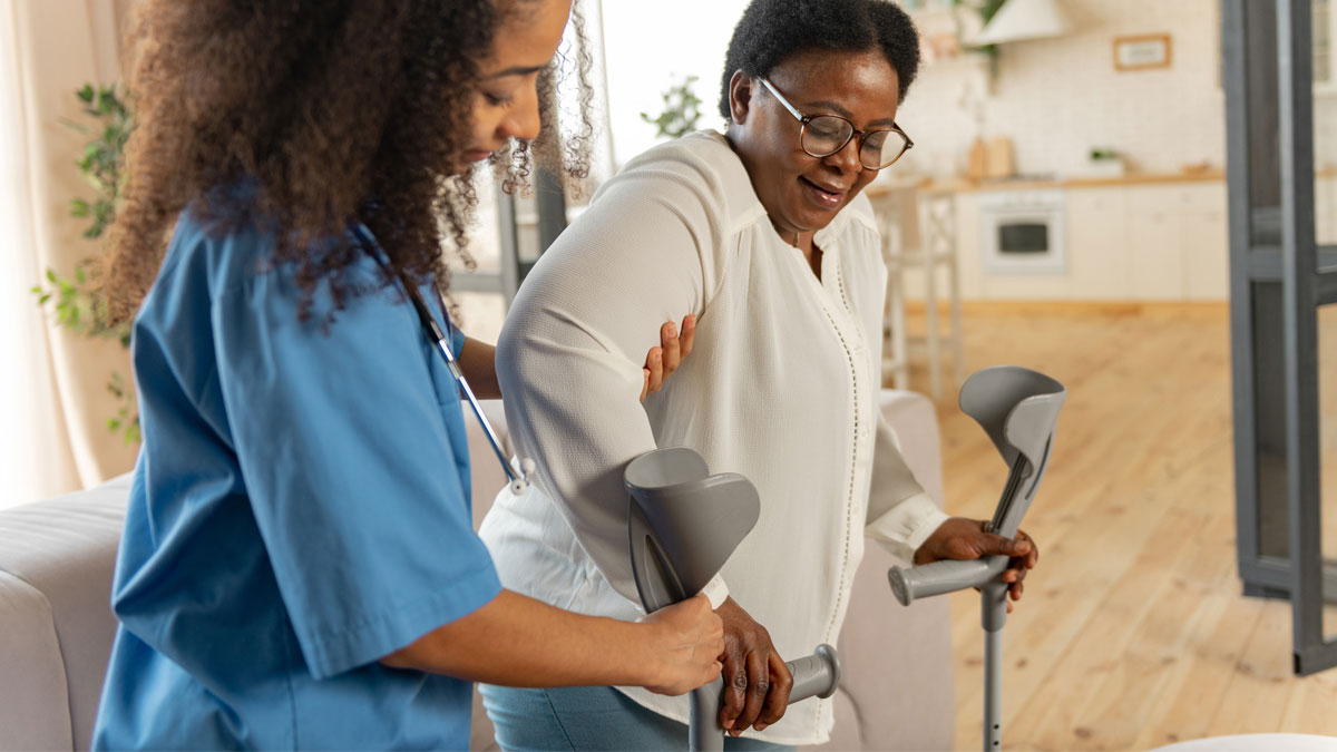 Physical therapist helping patient with post-surgery rehabilitation