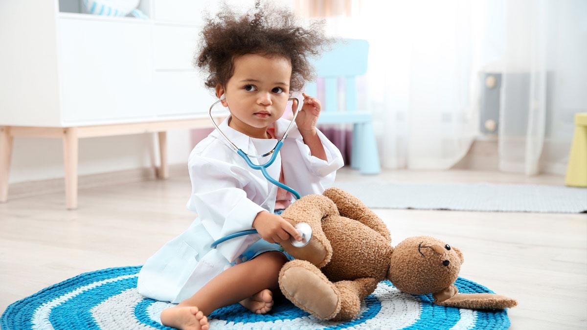 MIS-C Child holding stethoscope and stuffed animal
