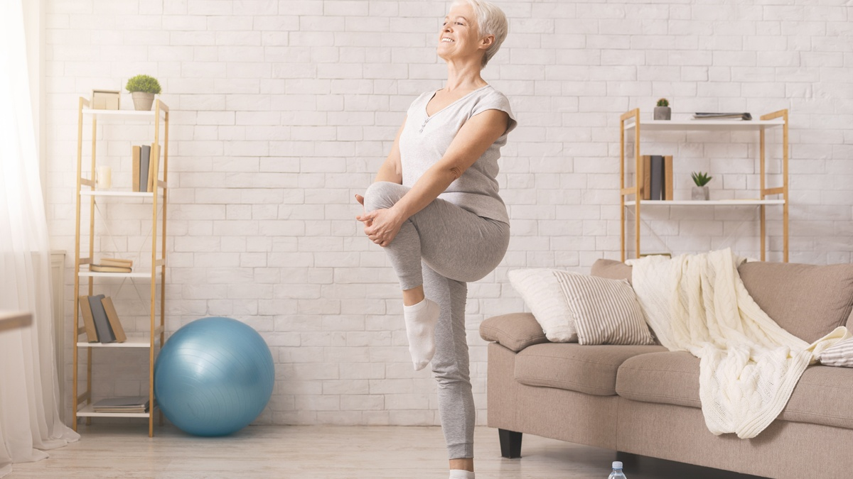 Older woman stretching before exercising
