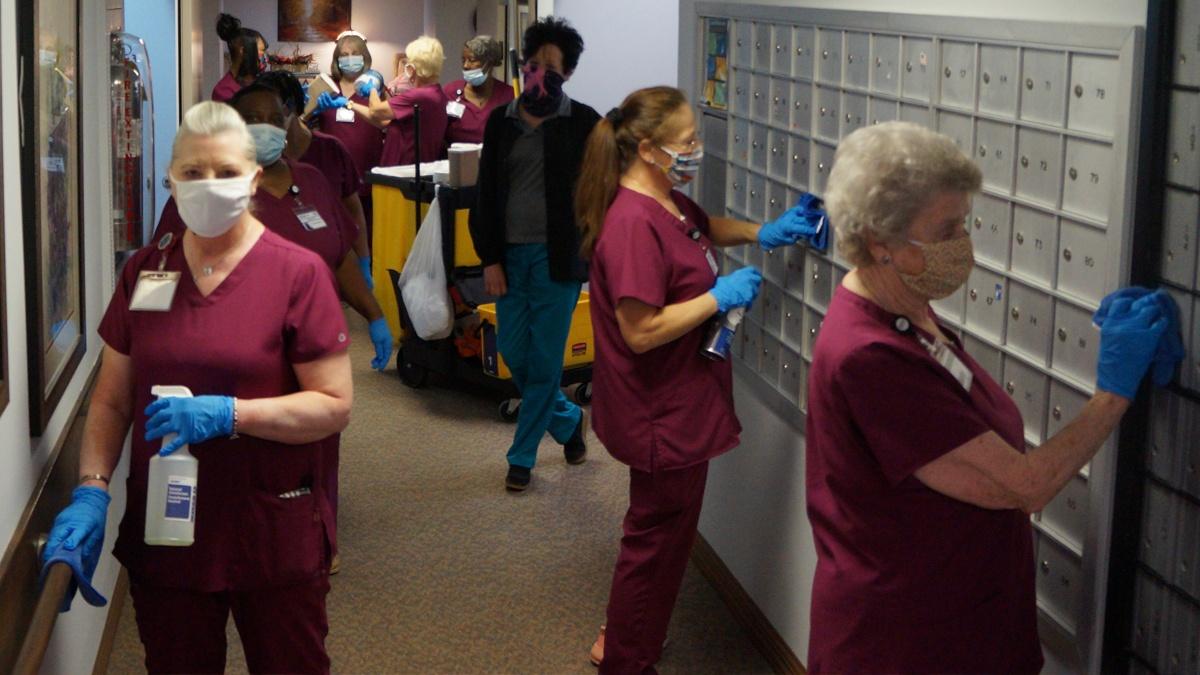 Workers sanitizing senior care facility
